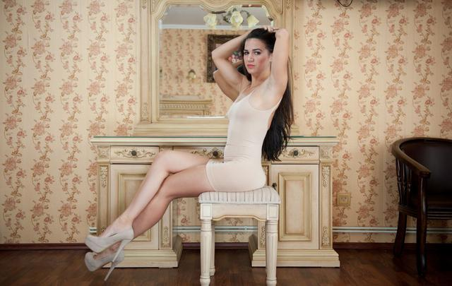 Portrait of sensual female posing provocatively