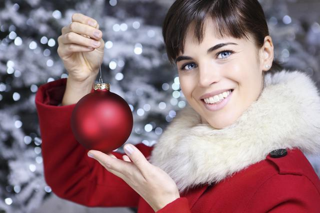 Christmas woman with red ball, smiling