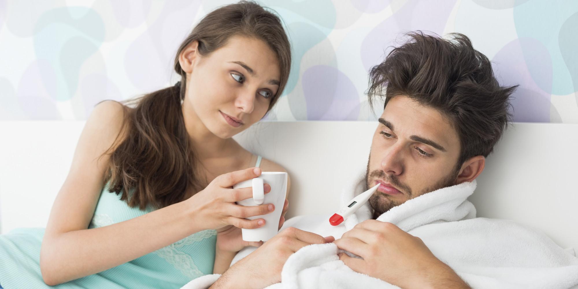 Young woman giving coffee mug to man